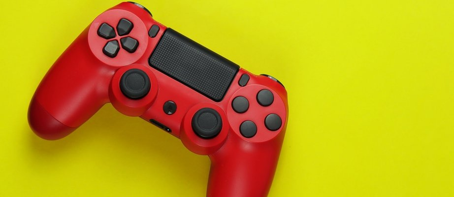 red-gamepad-on-yellow-background-G9VNSR6.jpg