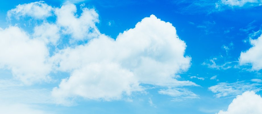 close-up-blue-sky-with-white-fluffy-cloudy-QLWPLT9.jpg