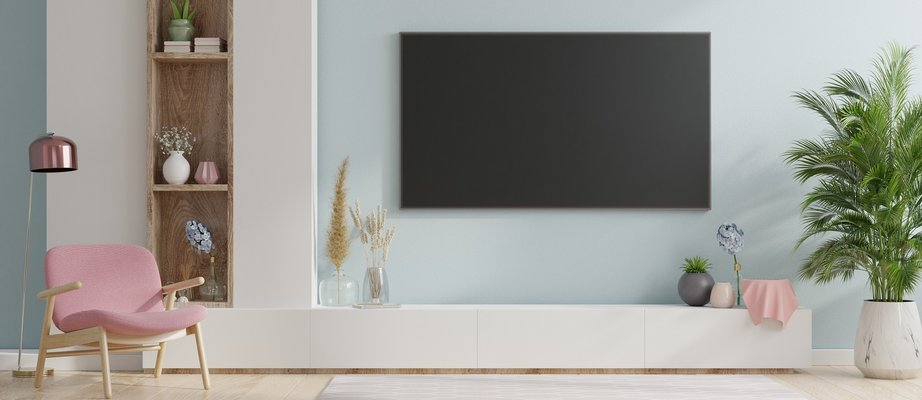 smart-tv-on-the-blue-wall-in-living-room-RB2SGZC.jpg