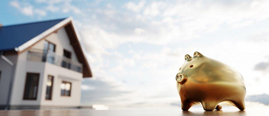 piggybank-and-new-house-saving-for-home-mortgage-TQLZCT6.jpg