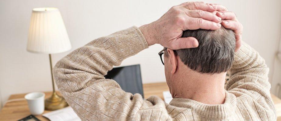 man-worried-about-bills-holding-hands-on-head-bein-2021-04-23-19-47-48-utc.jpg